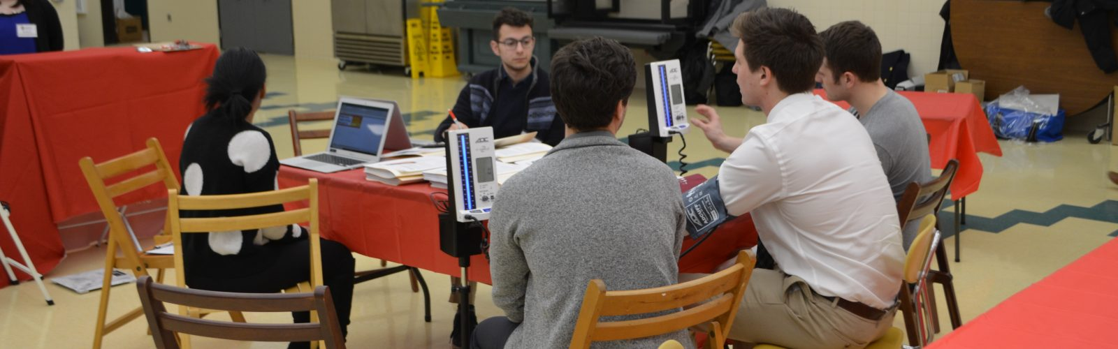 Health metrics being recorded at a health fair