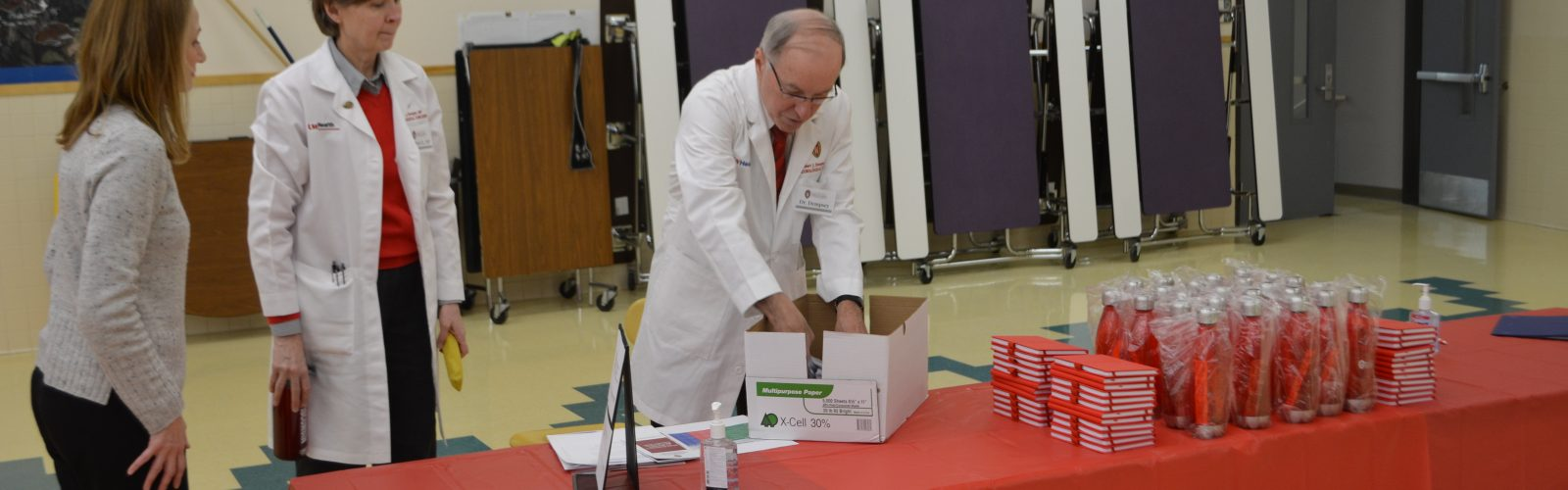 Researchers setting stuff up before a health fair