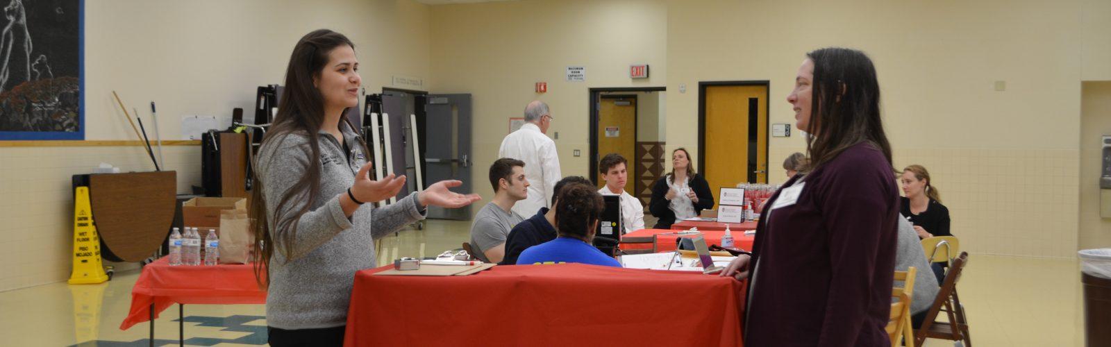 Volunteers talking before a health fair starts